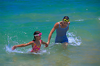 Mother and daughter swimming at Ulua beach, Maui