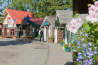 Visitors shop at the turn of the century log cabins, now used as gift shops, at the Historic Pioneer park in Fairbanks, Alaska.