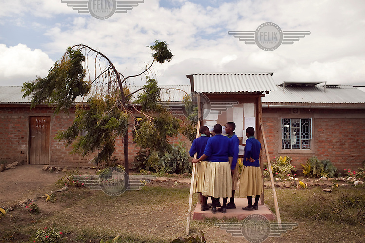 Students check their schedules at the Noonkondin Secondary School run by Gemma Enolengila and Lesikar Olengila.