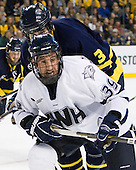 Phil DeSimone (UNH - 39), Kyle Bigos (Merrimack - 3) - The Merrimack College Warriors defeated the University of New Hampshire Wildcats 4-1 (EN) in their Hockey East Semi-Final on Friday, March 18, 2011, at TD Garden in Boston, Massachusetts.