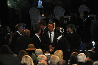(L-r) The former Governor of California Arnold Schwarzenegger before the memorial service for boxing legend Muhammad Ali at the KFC Yum! Center in Louisville, Kentucky on June 10, 2016.  Ali was involved in the planning of the ceremony which included speeches from leaders of numerous faith as well as comedian Billy Crystal and former American President Bill Clinton.