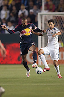 LA Galaxy defender Omar Gonzalez (4) battles New York Red Bulls forward Thierry Henry (14). The LA Galaxy and Red Bulls of New York played to a 1-1 tie at Home Depot Center stadium in Carson, California on  May 7, 2011....