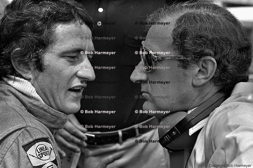 Patrick Depailler (left) with Derek Gardner, designer of the Tyrrell P34 six-wheel Formula 1 car, in the pit lane during practice for the 1976 Grand Prix of Monaco.