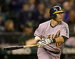 Oakland Athletics Daric Barton lines out against the Seattle Mariners  in the eight inning at SAFECO Field in Seattle April 13, 2012.  The Athletics beat the Mariners 4-0.    © 2012. Jim Bryant Photo. All Rights Reserved.
