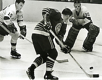 NHL hocky: California Seals Bill Hicke shoots toward L.A.Kings goalie Terry Sawchuk, #15 is Kings Ted Irvine. (1967-68 photo/Ron Riesterer)