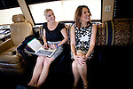 Republican presidential candidate, Rep. Michele Bachmann, right, and her press secretary Alice Stewart relax in her bus after a campaign stop held at a Pizza Ranch in Newton, Iowa, August 5, 2011.