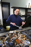 Kakiya restaurant, run by brother and sister, grilled oysters. Miyajima Island is famous for it's oysters. Hayashi Yuugi