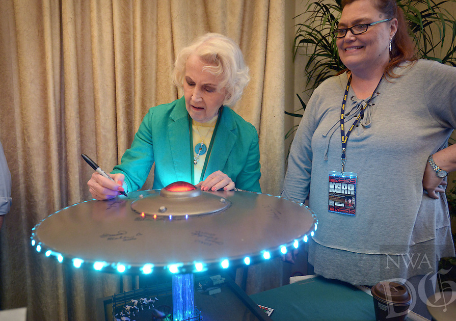 NWA Democrat-Gazette/BEN GOFF @NWABENGOFF<br /> Barbara Lamb, a guest speaker, autographs a flying saucer UFO model on Saturday April 9, 2016 during the 29th annual Ozark Mountain UFO Conference at the Best Western Inn of the Ozarks in Eureka Springs.