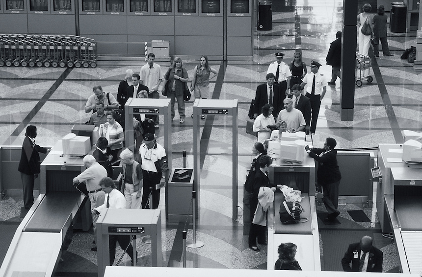 Overview of airline travelers clearing security at Denver International Airport. Colorado.