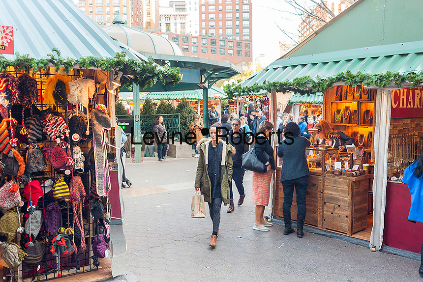 """Shoppers browse the Union Square Holiday Market in New York on opening day, Thursday, November 17, 2016. Over 100 vendors sell their holiday wares at the market which includes """"Lil' Brooklyn"""" and """"UrbanSpace Provisions"""" sections. Now in it's 23rd year, the market will remain open daily, closing on December 24.  (© Richard B. Levine)"""