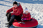 Happy Smiling Young Girl Kid and Teenage Boy on Otep&auml;&auml; Snowtubing Track,  Estonia