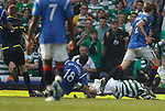 Carlos Bocanegra takes out Georgios Samaras for a late penalty
