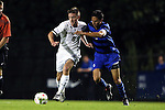 17 October 2014: Notre Dame's Nick Besler (8) and Duke's Sean Davis (6). The Duke University Blue Devils hosted the Notre Dame University Fighting Irish at Koskinen Stadium in Durham, North Carolina in a 2014 NCAA Division I Men's Soccer match. Notre Dame won the game 4-1.