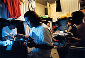 France, Paris, 05-2003..Illegal Chinese at a safe house in Paris. They are a new wave of immigrants from China?s northeast, home to millions of former cradle-to-grave factory workers laid off by closures. ..