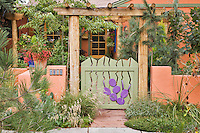 The front gate and entry of Dan Johnson's Devner garden only suggests the many creative  features of the gaden itself.