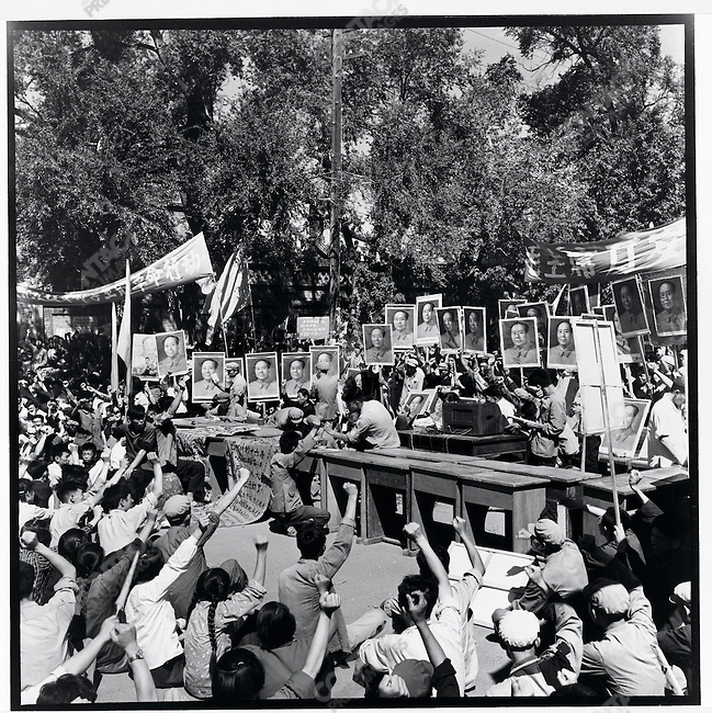 Masses gathered in front of the Jile Temple cheer as Red Guards from the Harbin Military Institute force self-criticism on the monks after vandalizing their sanctuary. Harbin, 24 August 1966
