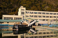 Cars swept into a school swimming pool by the March 11 tsunami, Ishinomaki, Miyagi Prefecture, Japan, May 5, 2011. Almost two months after the devastating earthquake and tsunami the reconstruction has barely begun.