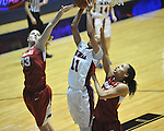 Ole Miss' Diara Moore (10) vs. Arkansas' Melissa Wolfe (33) and Arkansas' Jhasmin Bowen (42) in a women's college basketball game in Oxford, Miss. on Thursday, January 31, 2013. Arkansas won 77-66.