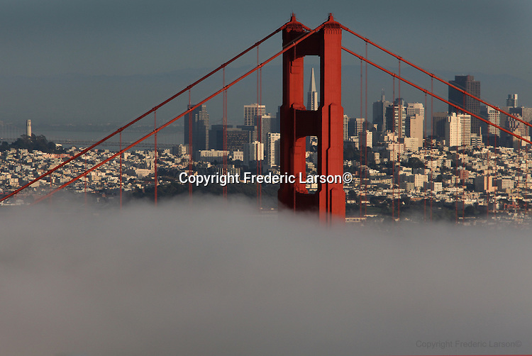 The winter fog underlines the city skyline during the evening twilight hours as seen from the Marin Headlands.