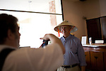Dr. James Brandt, left, of Sacramento, Calif., takes a photo of Dr. Steve Charles wearing a traditional Vietnamese nong la conical hat before examining their post operative patients on the last day of the ORBIS Flying Eye Hospital program. Photo taken Friday, April 18, 2008...ORBIS Flying Eye Hospital brought doctors, nurses and specialists from all over the world to Ho Chi Minh City, Vietnam from April 7-18, 2008.  The ORBIS program contributed to the efforts of Ho Chi Minh City Eye Hospital in fighting avoidable blindness by educating local ophthalmologists to diagnose and manage pediatric blindness, retinal disease, oculoplastics, and blindness due to glaucoma.
