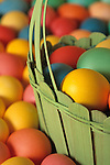 Colorful eggs in green wooden basket, close-up, Easter time, Marysville, Washington USA