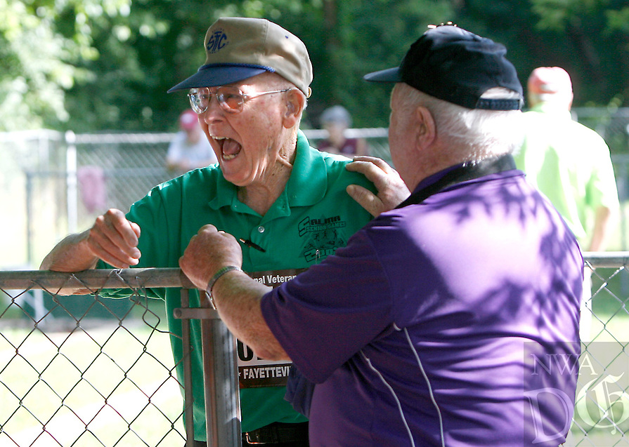 NWA Media/DAVID GOTTSCHALK - 6/30/14 - Clifford Metzger, 86, of Salina, KS., reacts after hearing he won the bronze medal in the 85 plus division of horse shoes from Ray Poynter, 90, right, of Fayetteville Monday June 30, 2014 at Walker Park in Fayetteville during the 28th annual National Veterans Golden Age Games. The games include bowling, swimming and checkers among other activities.