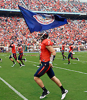 Sept. 3, 2011 - Charlottesville, Virginia - USA; Virginia Cavaliers safety Corey Mosley (7) runs with the Virginia state flag during an NCAA football game against William & Mary at Scott Stadium. Virginia won 40-3. (Credit Image: © Andrew Shurtleff)
