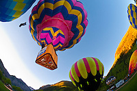 Hot air balloons flying above Telluride during the Telluride Balloon Festival, Telluride, Colorado USA