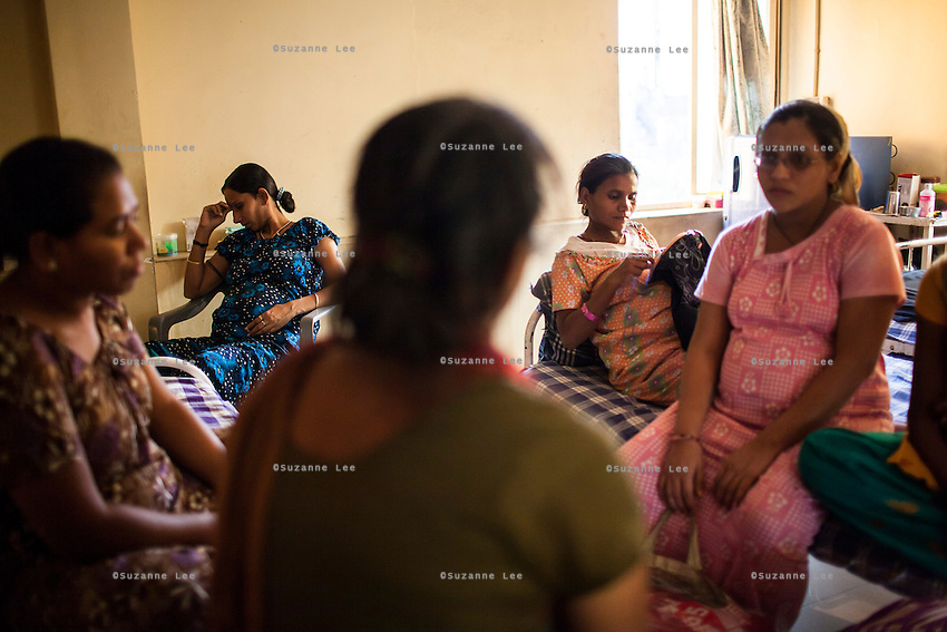 Surrogates pass their time doing embroidery and watching television in the surrogates hostel on the 3rd floor of Dr. Nayana Patel's Akanksha IVF and surrogacy center in Anand, Gujarat, India on 10th December 2012. Photo by Suzanne Lee / Marie-Claire France