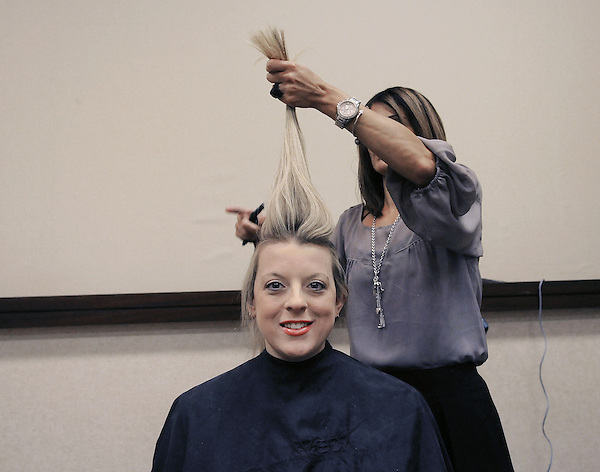 Myrtle Beach, South Carolina: January 15, 2012<br /> <br /> Michele Sullivan, 32, a model, gets her hair styled prior to a bridal show at the Sheraton Convention Center. The issue that matters the most to her is medical insurance. As a healthy and somewhat young person, she considers it unfair that she must pay a high premium that pools the coverage for people of all ages and conditions. &copy;Chris Fitzgerald / CandidatePhotos