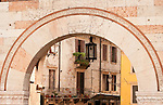 Looking through an archway to a street in Verona, Italy.