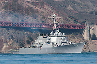 "The USS John Paul Jones (DDG-53) passes under the southern span of the Golden Gate Bridge during the Parade of Ships as part of the 2006 San Francisco Fleet Week activities. The USS John Paul Jones (DDG-53) was commissioned on December 18, 1993 as the third Arleigh Burke guided missile destroyer, and is homeported in San Diego, California. The ship is named in honor of Naval hero, John Paul Jones, and derives her motto, ""In Harms Way,"" from a famous quote of his, ""I wish to have no connection with any ship that does not sail fast, for I intend to go in harm's way.""  Photographed 10/06"