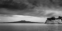 Motutapu Islands Emu Point to the right and the symmetrical volcanic cone of Rangitoto Island behind.
