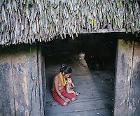 Abai Lau Lau, a Mentawai woman living in the village of Buttui. The Mentawai are the tribes living traditionally in the island of Siberut, Indonesia. Here, where the changes came slow, some of the people are still living like their ancestors did centuries ago. They s till practice ancient religion called Arat Sabulungan, which believe that everything in the forest has a spirit.