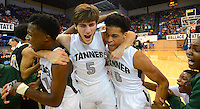 Photo by Gary Cosby Jr.  Tanner High players Desmond Love, Blake Whitt and Johnathan Fletcher celebrate Fletcher's buzzer beating three pointer that defeated Vincent High and sent Tanner to the state semi-final game.