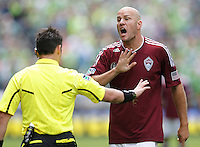 Colorado Rapids forward Conor Casey protests a call with referee Edvin Jurisevic during play against the Seattle Sounders FC at CenturyLink Field in Seattle Saturday July 16, 2011. The Sounders won the game 4-3.