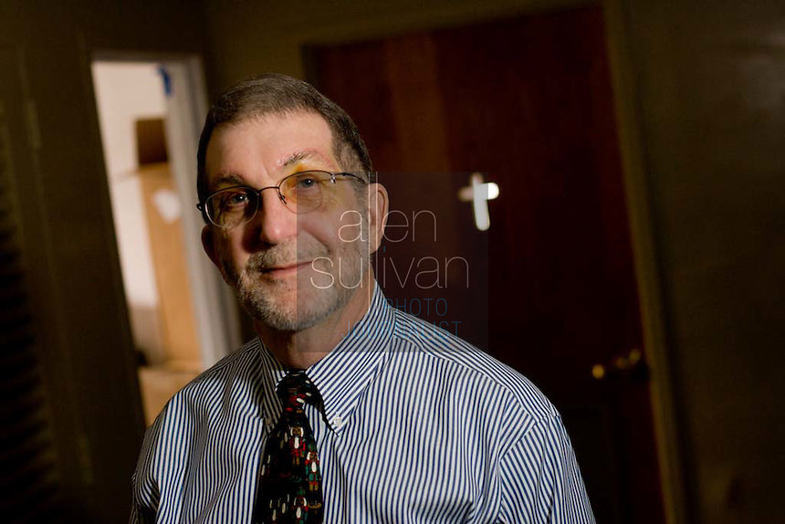 Rev. Frank Windom was shot while filling up his car six years ago. He lost a large amount of blood and almost died, while another victim at the Quik Trip was killed. (In the photo, his eyes are bruised from an unrelated surgery.)