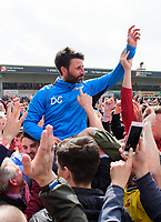 Lincoln City manager Danny Cowley is lifted onto the shoulders of fans at the end of the game<br /> <br /> Photographer Chris Vaughan/CameraSport<br /> <br /> Vanarama National League - Lincoln City v Macclesfield Town - Saturday 22nd April 2017 - Sincil Bank - Lincoln<br /> <br /> World Copyright &copy; 2017 CameraSport. All rights reserved. 43 Linden Ave. Countesthorpe. Leicester. England. LE8 5PG - Tel: +44 (0) 116 277 4147 - admin@camerasport.com - www.camerasport.com
