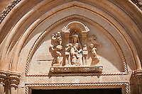 The Italian Gothic medieval relief sculptures of the Madonna & Child over the main door of the Cathedral of Ostuni built between 1569-1495  .Ostuni, The White Town, Puglia, Italy.