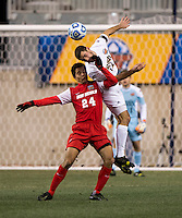 Andrew O'Malley (12) of Notre Dame goes up for a header with Niko Hansen (27) of New Mexico during the NCAA Men's College Cup semifinals at PPL Park in Chester, PA.  Notre Dame defeated New Mexico, 2-0.