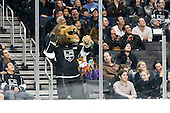Bailey, official mascot of Los Angeles Kings, with coyote during ice-hockey match between Los Angeles Kings and Phoenix Coyotes in NHL league, March 3, 2011 at Staples Center, Los Angeles, USA. (Photo By Matic Klansek Velej / Sportida.com)