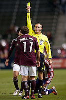 Referee Terry Vaughn keeping the match in check showing Rapids midfielder Brian Mullan (11) yellow. The Colorado Rapids defeated CD Chivas USA 1-0 at Home Depot Center stadium in Carson, California on Saturday March 26, 2011...