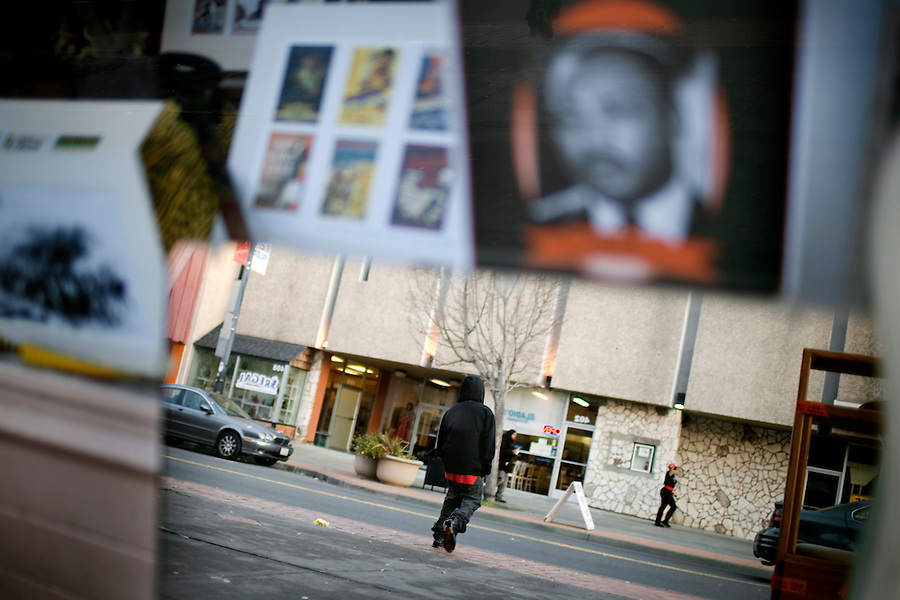 A man, reflected off a mirror, crosses Georgia street, in downtown, in Vallejo, Ca., on Wednesday, Feb. 10, 2010. Recent crime wave has residents and businesses on edge.
