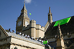 Greenpeace activists occupy the roof of the parliament in downtown London. (©Robert vanWaarden)