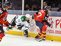 Florida Panthers' Tom Gilbert, right, battles Dallas Stars' Luke Gazdic for the puck during the first period of an NHL preseason hockey game, Friday, Sept. 20, 2013, in San Antonio, Texas. Dallas won 4-1. (Darren Abate/DA Media)