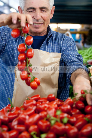 Vendor selling fresh tomatoes at Testaccio, Rome, Italy