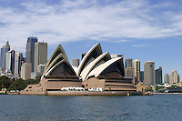 Sydney Opera House with city skyline behind.<br />