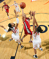 Dec. 6, 2010; Charlottesville, VA, USA; Radford Highlanders guard Erica Rivera (23) shoots over Virginia Cavaliers center Simone Egwu (4) and Virginia Cavaliers guard Ataira Franklin (23) at the John Paul Jones Arena. Virginia won 76-52. Mandatory Credit: Andrew Shurtleff-