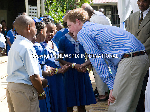 """PRINCE HARRY_.meets young children who put on a performance entitled """"Dance In Africa"""", at the Garrison Museum, Barbados. Prince Harry is on a 3-day  Royal Tour of Barbados_30/01/2010.Mandatory Credit Photo: ©DIAS-NEWSPIX INTERNATIONAL..**ALL FEES PAYABLE TO: """"NEWSPIX INTERNATIONAL""""**..IMMEDIATE CONFIRMATION OF USAGE REQUIRED:.Newspix International, 31 Chinnery Hill, Bishop's Stortford, ENGLAND CM23 3PS.Tel:+441279 324672  ; Fax: +441279656877.Mobile:  07775681153.e-mail: info@newspixinternational.co.uk"""