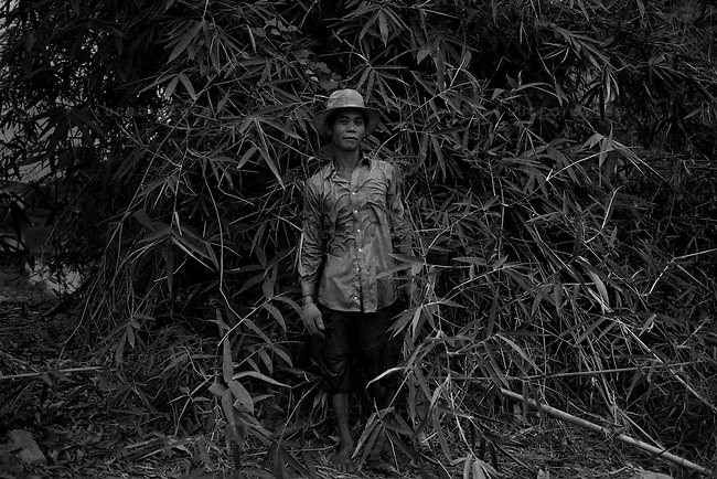 Vietnamese port worker outside of Ho Chi Minh City, Vietnam.